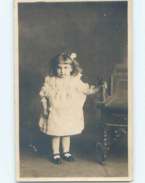 Pre-1918 rppc CUTE GIRL GRABS WOODEN CHAIR Canada - Alberta Bc Quebec ON HM4269