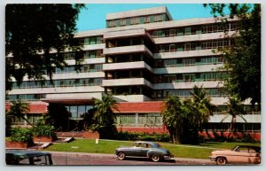St Petersburg Florida~Mound Park Hospital~1940-50s Cars in Front~Pink Auto~1956
