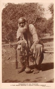 Lot142 real photo tribesman of nwfp turi waziri smoking a hookah pakistan