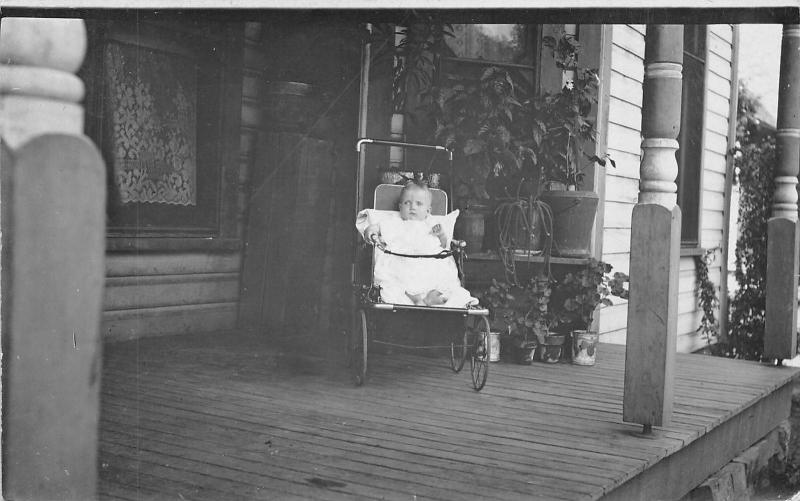 Real Photo Postcard~Infant in Vintage Baby Buggy on Victorian Porch~1912 RPPC
