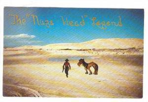 The Nags Head Legend, Man and Donkey crossing desert, North Carolina, 40-60s