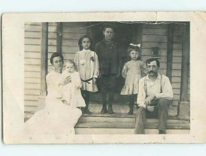 Pre-1920's rppc CUTE GIRL WITH BOW IN HAIR WITH SIBLINGS & PARENTS r6295