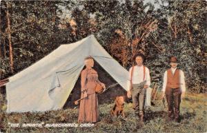 BLANCHARDS CAMP MAINE~THE SPORTS-WOMAN FLY FISHING-MAN W/ PISTOL & DOG POSTCARD