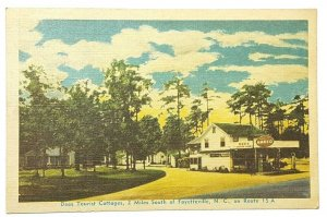 c1945 Amoco Gas Station Dees Tourist Cottages S of Fayetteville NC Postcard A29