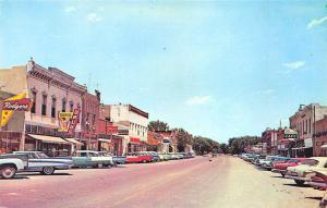 Sterling KS Street View Store fronts Old Cars Postcard