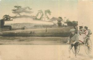 Handcolored Postcard. Japanese Man Pulling Rickshaw Pulling 2 Women