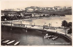 Switzerland Zuerich Quaibruecke und Utoquai, boats, bridge, trams, mountains