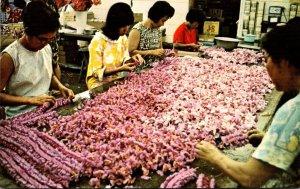 Hawaii Honolulu Native Girls Making Orchid Leis