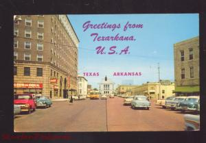 GREETINGS FROM TEXARKANA TEXAS ARKANSAS 1950's CARS VINTAGE POSTCARD DOWNTOWN