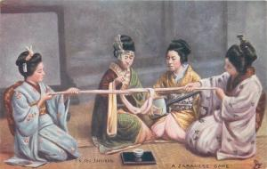 Geisha girls playing a japanese game Tuck vintage postcard