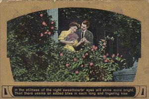 Romantic Couple in Garden Woman Holding Fan