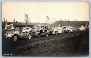 Lone Tree Iowa~A Scene From Our Homecoming~Decorated Car Parade in Mud~1918 RPPC