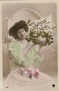 RP: CHRISTMAS, PU-1909; Joyeux Noel, Woman with gifts on her lap