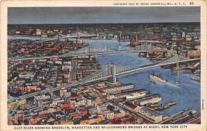 N.Y. East River showing Brooklyn, Manhattan and Williamsburg Bridges at Night