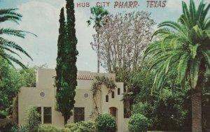 Hub City, PHARR , Texas , 1966 ; Hotel with Jacaranda trees with blue flowers