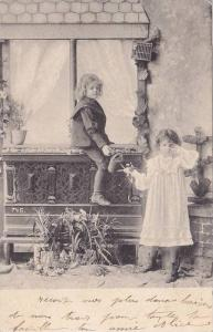 Boy on fence giving crying girl a watering can, PU-1904