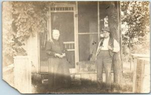 1912 Oklahoma RPPC Photo Postcard Older Couple Screened Porch BRISTOW OK Cancel