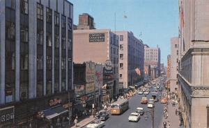 Montreal Quebec~St Catherine Street~Peoples~Restaurant~1950s Cars~City Bus