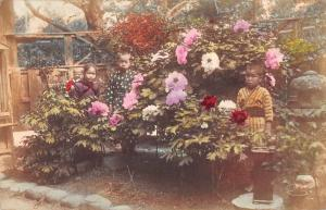 Japan Children in Garden with Flowers Tinted Real Photo Antique Postcard J81224