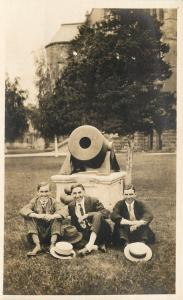 3 Dapper Univ Men Sit in Front of Cannon & Cannon Balls~Boater Hats RPPC c1908
