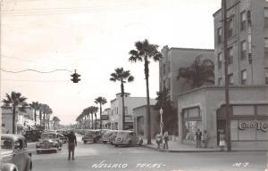 Weslaco Texas~Cop Directs Traffic~Cortez Drugs~Mattar Bros Men's Store~1950 RPPC