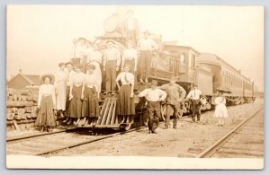 RPPC Lumber Yard~Guys & Gals Gather on Train Engine #12~Girl w/Umbrella c1910