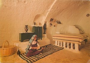 Tunisia native house bed woman reading cave postcard