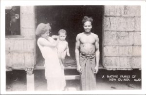 RPPC-Paupa, New Guinea A Native Family WWII No. 10 Grogan Photo