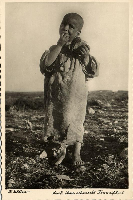 libya, Young Arab Boy enjoys his Kommissbrot (1940s) H. Schlösser Photo