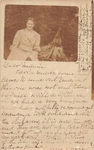 Driftwood Girl with Tree Stump Postal Used Real Photo Antique Postcard J73263