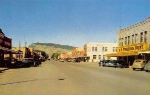 CODY, WY Street Scene VR Trading Post Wyoming Vintage Postcard ca 1950s