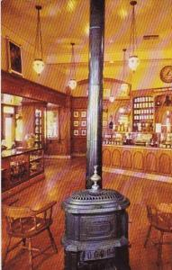 Pot Bellied Stove And Hanging Chandeliers Set The Mood Of Upjohns Old Fashion...
