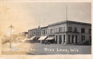 Rice Lake WI Hon's Variety Store~1st National Bank~Basement Barbershop~RPPC 1922