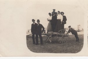 RP: LOOMIS , Nebraska , 1909 ; People posing on a cart