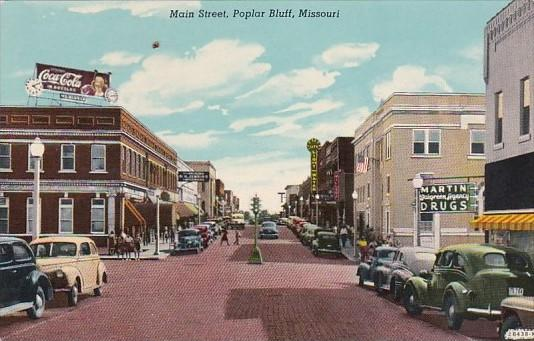 Main Street With Drug Store & Coca Cola Sign Poplar Bluff Missouri