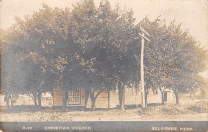 Belvidere NE~Christian Church Behind Trees~Telephone Pole~Halldorson RPPC 1909