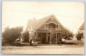 RPPC Grandma & Grandpa~3 Grandkids~New Bungalow w/Ornate Recessed Balcony~c1910