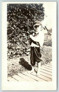 RPPC Pleasant, Barefoot Boy Embraces Cat~Ballcap~Walks on Plank Sidewalk~c1910