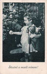 Child with teddy bear at Christmas Tree , 1920-30s