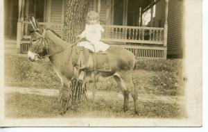 US    PC472   LITTLE GIRL ON DONKEY