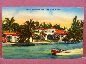 Postcard FL Miami A Waterfront Home Speedboat