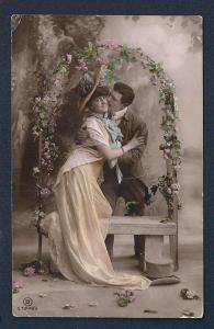 Loving Couple embracing under Rose Arch RPPC used c1910