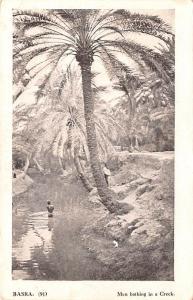 Basra Iraq Men bathing in a Creek Basra Men bathing in a Creek
