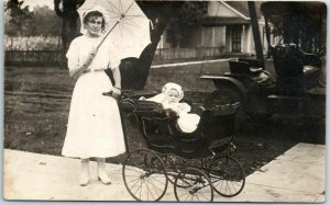 1910s RPPC Real Photo Postcard Young Woman w/ Baby in Stroller & White Parasol