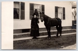 Keene New Hampshire~Woman in Winter Coat Holds Black Horse~Home~1910 RPPC