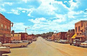 Gillette WY Business Section Storefronts Old Cars Fiesta Theatre Postcard