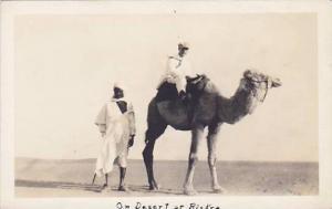 RP: Men & Camel on the desert , BISKRA , Algeria , 1910s