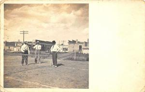 Wilber NE Men on Tennis Court Downtown in Background Real Photo Postcard