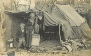 RPPC Hardscrabble Poverty Woman & Son at Tent Camp with Washboard & Laundry