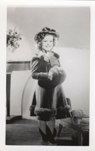 RP; Shirley Temple wearing fur trimmed coat and hand muff, 1930-50s